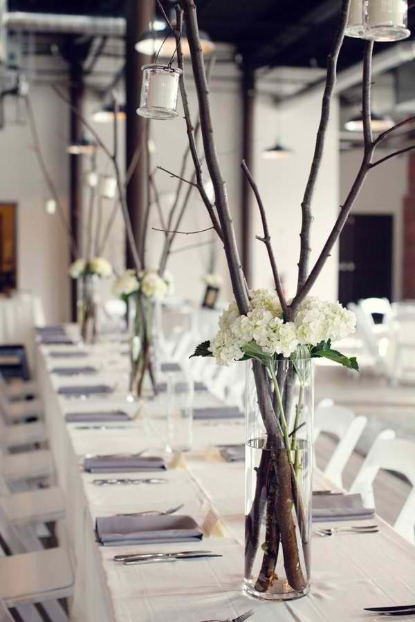 Tall, simple centerpieces. Add a lot more color and it would do quite well.