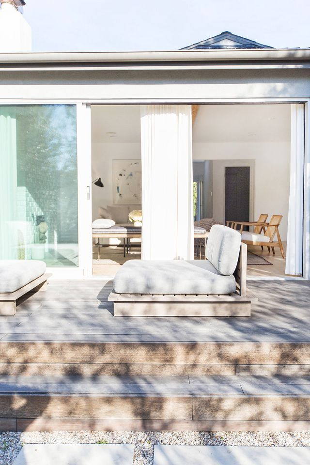 Never ones to leave a stone unturned, Passman and Segal ensured that relaxed feeling could be felt on the home's patio. Can we please lounge on those daybeds too?