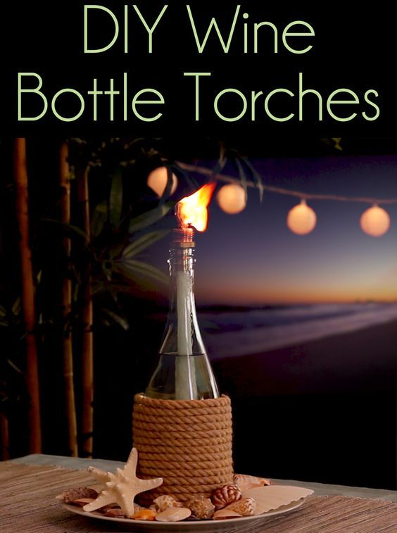 Wine Bottle CITRONELLA Candles ~~~ Remove labels & scrub bottle ~ Decorate with rope or twine ~ (OPT) Fill with small pebbles or marbles (to use as less torch fuel!) ~ Pour in the fuel a few inches from the top ~ A small brass coupling works well to keep your wick in place ~ Depending on the thickness, a ½–¾ coupling fits a wick perfectly ~ Push it through about 1½ inches ~ Place it in the bottle, and let it soak up the fuel for about 20 mins ~ Set torch outside, light it & Enjoy!