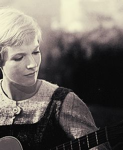 Julie Andrews in the Sound of Music. She actually had to learn HOW to play the guitar for this role as Maria