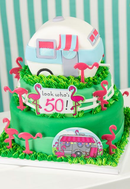 Big Milestone, 50th Birthday Cake with flamingos and RV Camper made out of fondant. #overthehill #50thbirthdaycake