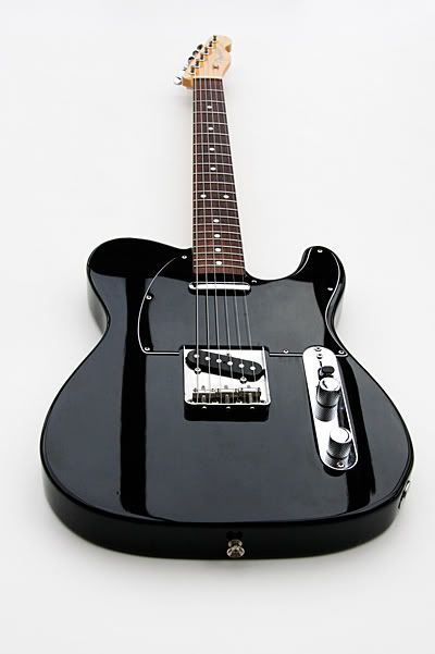 Black telecaster image by BadBobBates on Photobucket... like the dark stripes caused by light reflection