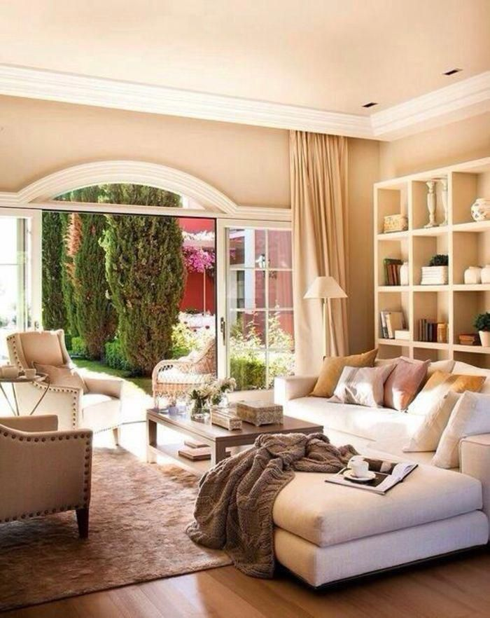 Living Room With Pale Orange Walls And Ceiling White Plaster Details Cream Sofa And Chairs Brown Living Room Brown Living Room Decor Brown Sofa Living Room