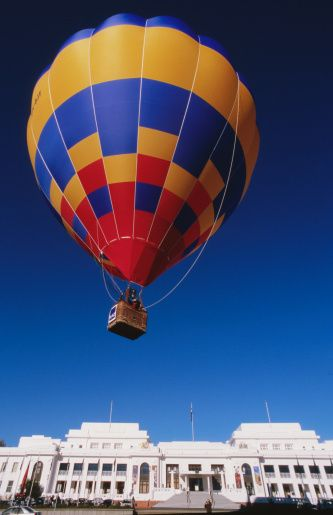 Hot air balloon flying over Old Parliament House - Canberra, Australia