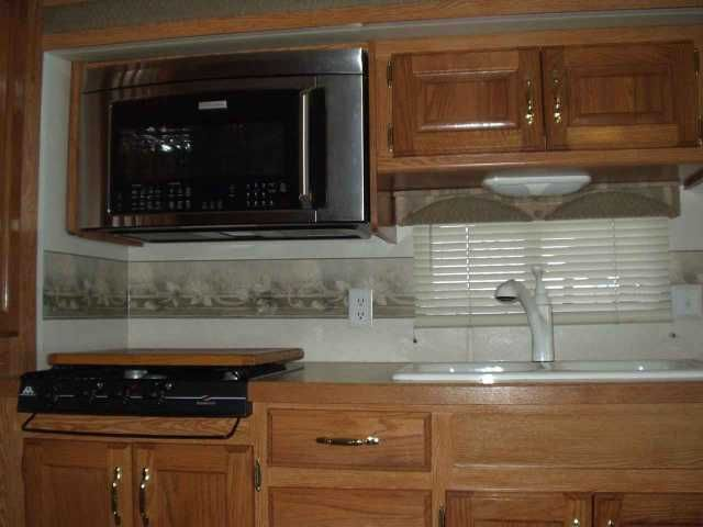 """2002 Used Monaco Cayman Class A in Texas TX.Recreational Vehicle, rv, 2002 Monaco Cayman , Excellent condition, non-smoking, 2 slide outs - 1 in living/kitchen area and 1 in bedroom. RV was stored inside when not in use. Numerous upgrades include new couch, new queen size mattress, new convection/microwave oven, newly upholstered dinette, new flat screen Vizio TV's, 32"""" in main area and 19"""" in bedroom, new Sony DVD player, new Sony AM/FM/CD radio with Bluetooth, USB and AUX outlets and…"""