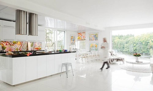 I like this kitchen because of the vibrant Josef Frank design or Josef Frank 'look alike' on the backsplash and the bright paintings.  I think this is not as overly white as pictured.