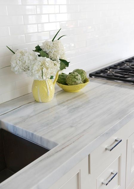 Quartzite stone counters (Luce de Luna) resembles marble but is is a bit less porous and therefore less susceptible to staining.