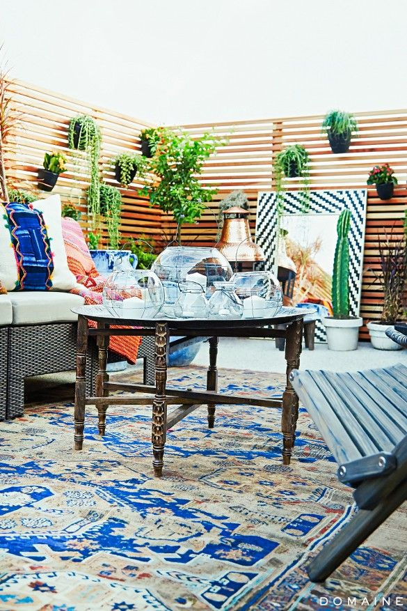Jen Atkins Rooftop by @consortdesign with succulents and mixed indigo textiles.