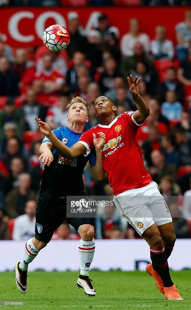 Bournemouth's English midfielder Matt Ritchie (L) vies with Manchester United's French striker Anthony Martial during the rescheduled English Premier League football match between Manchester United and Bournemouth at Old Trafford in Manchester, north west England, on May 17, 2016. The match, originally scheduled for May 15, was called-off minutes before kick-off following the discovery of a suspect device, which turned out to be a fake bomb left in the stadium by mistake after a terror…
