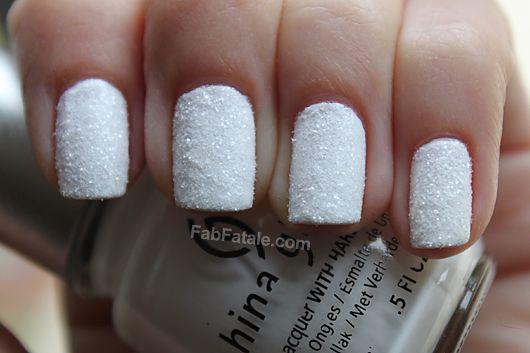 Holiday Christmas Snow Manicure.. China Glaze Frosty and white glitter.