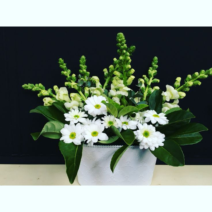 Table centerpiece by Bettie bee blooms for Hamper Girl at the Geelong Small Business Expo. White chrysanthemums, verbernum, white snap dragons.