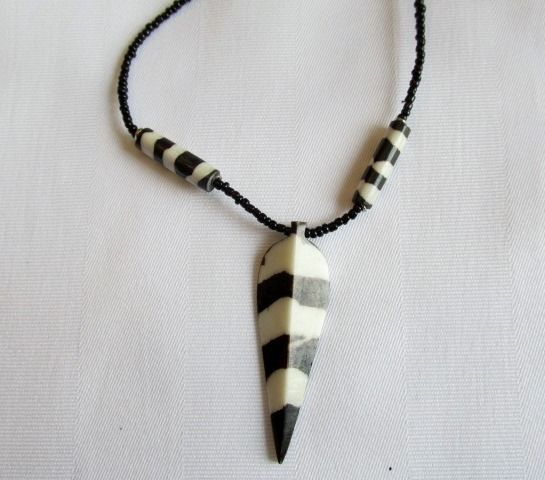Shared Treasures Boutique - African Bone and Bead Spear Necklace - (Zulu), $11.99 (http://www.sharedtreasuresboutique.com/african-bone-and-bead-spear-necklace-zulu/)