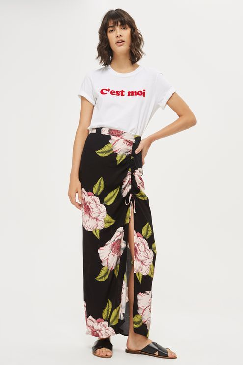 Option for floral power this season with this charming floral print maxi dress. Boasting a flattering ruched detail and front split, tuck in a slogan top to complete a casual look.