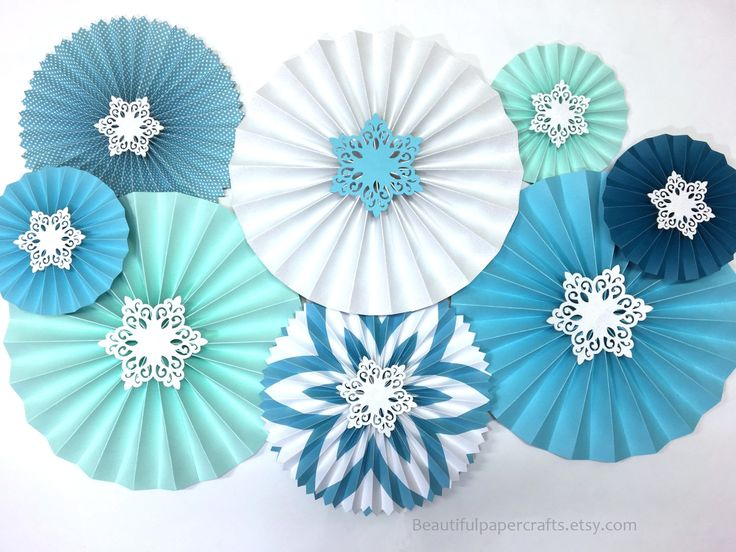 Please check individual items to see our shipping times and policies. _______________________________________________________________________________________________________________________________________  Paper Rosettes sparkly white glitter snowflakes embellishment adds a fun and and playful touch to your winter theme party.  This set of Rosettes/Paper Fans are created using 80lb solid card stock and pattern papers. Set of 8 Rosettes includes  3 - 12 Rosettes 1 white glitter rosette, ...