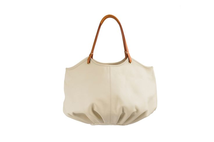 This season, complete your elegant look with the Parchment Talega