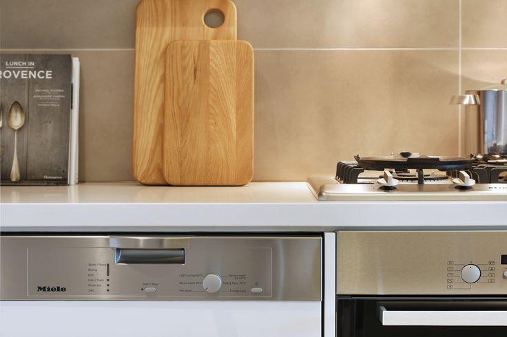 Kitchen in light colour scheme.  #salvopropertygr #precinctapartments #kitchen