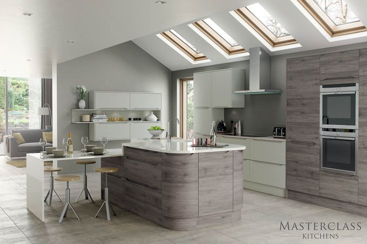 Used curved units to soften the look of your modern kitchen design. Our Luna Semi Handleless range in smoked oak & mussel is pictured here.