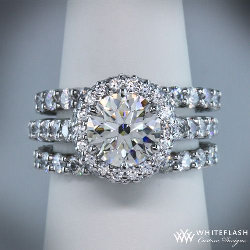 Engagement ring with two wedding bands. Yes!...wow, I've never really liked a round stone before but this is gorgeous!