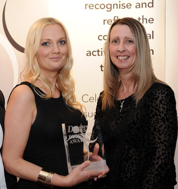 Jessica Eyre and Lisa Morris holding a Derbyshire Times Business Award