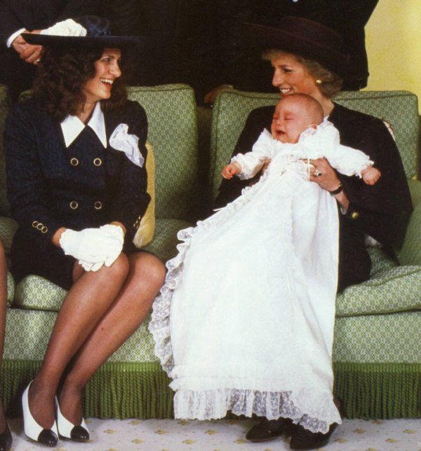 April 23, 1989: Princess Diana at the christening of her godson, Lord Edward Downpatrick seated next to his mother, the Countess of St. Andrews.