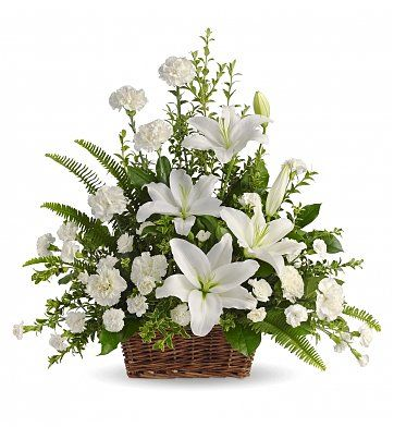 Peaceful White Lilies Basket: Funeral Flowers - A tasteful basket of pure white blossoms to offer peace and serenity.