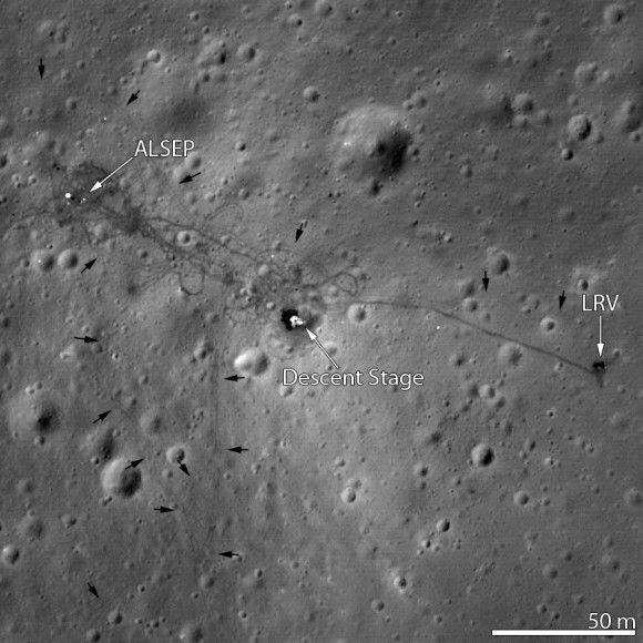 The Apollo 15 landing site at Hadley plains, taken by the Lunar Reconnaissance Orbiter from an altitude of 15.5 miles (25 kilometers) in 2012. Visible is the descent stage of Falcon (the lunar module), the Lunar Roving Vehicle (LRV) and the Apollo Lunar Surface Experiment Package (ALSEP). The site is marked by rover tracks. Credit: NASA Goddard/Arizona State University