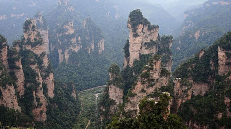 A general view of the Tianzi Mountain at Zhangjiajie national park in Zhangjiajie, China. Zhangjiajie is home to striking sandstone and quartz cliffs and its mountain formations are famously known for as the inspiration for the fictional world 'Pandora' in the film, 'Avatar'. (Lintao Zhang/Getty Images) | Strange Natural Wonders of the World (PHOTOS) | The Weather Channel