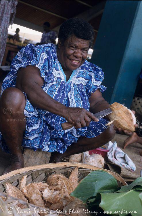 selling coconuts at the daily open market, Port Vila, Efate Island, Vanuatu.