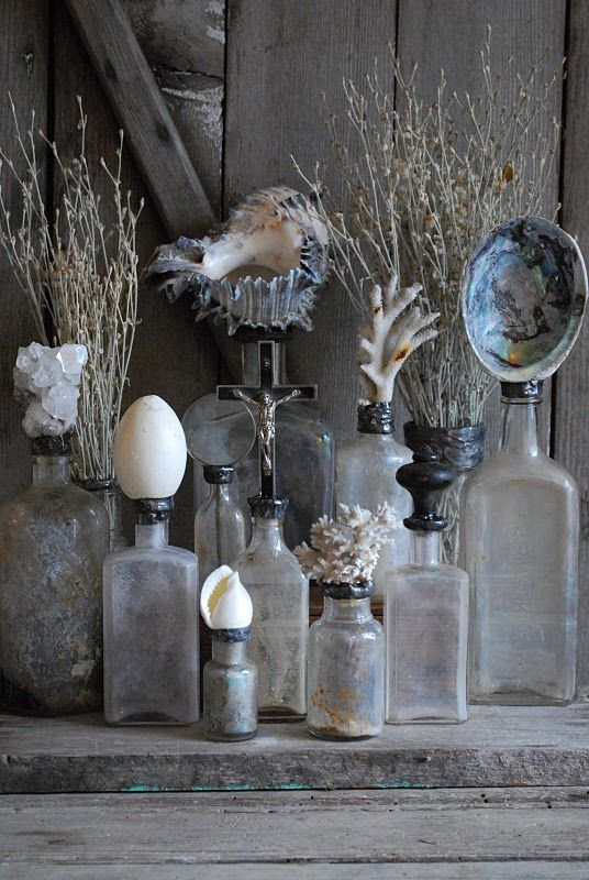 Old glass bottles w/ shell tops. I can see these in a bathroom with bath salts in them.