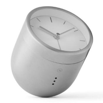 Menu Menu Tumbler Alarm Clock - Brushed Steel: An updated version of the traditional alarm clock design, Norm's round-faced clock sits atop a round bottomed brushed steel base and must be turned over and positioned face down in order to silence the alarm.