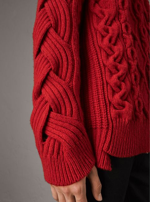 A relaxed cashmere wool Burberry sweater artfully framed with notched rib-knit trims