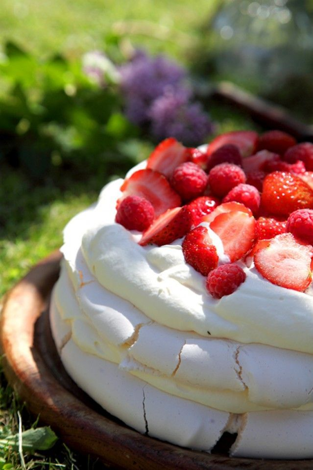 Traditional Irish Recipe:  Summer Berry Pavlova; A Crisp & Chewy Marshmallow Meringue Layer Stacked with Soft Whipped Cream & Sweet Berries.