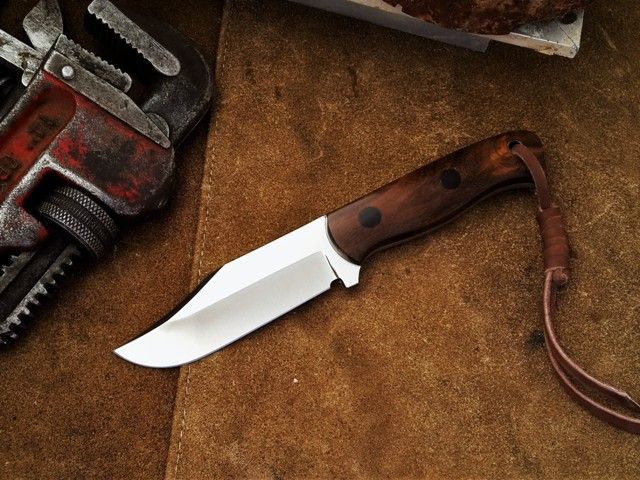 Utility general purpose knife by South African Knife maker Louis Naude. This knife on the picture is called the Stark (meaning strong) and it has a Leadwood handle. It is available from Louis Naude knives (LEO Knives). Just waiting for your choice of handle material that includes a selection of African hardwoods and synthetic materials.  Louis Naude knives ships worldwide.
