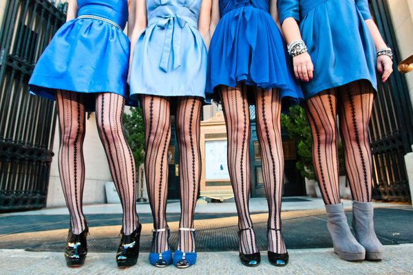 Fashion forward maids in blue dresses and black patterned tights.