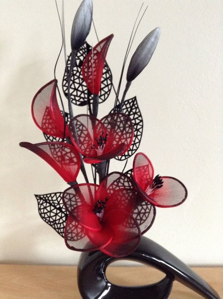Artificial Flower Arrangement Made With Red Nylon Flowers In Black Vase