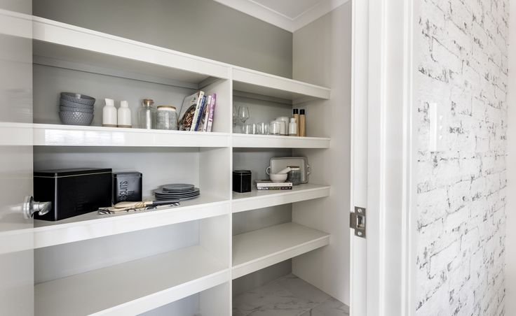 The walk-in pantry offers ample storage