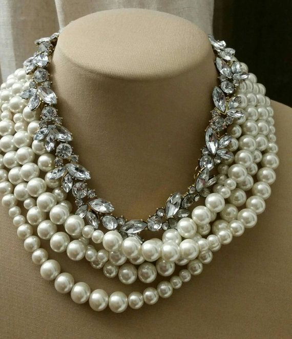 Check out this item in my Etsy shop https://www.etsy.com/ca/listing/251062265/multistrand-glass-pearl-and-rhinestone