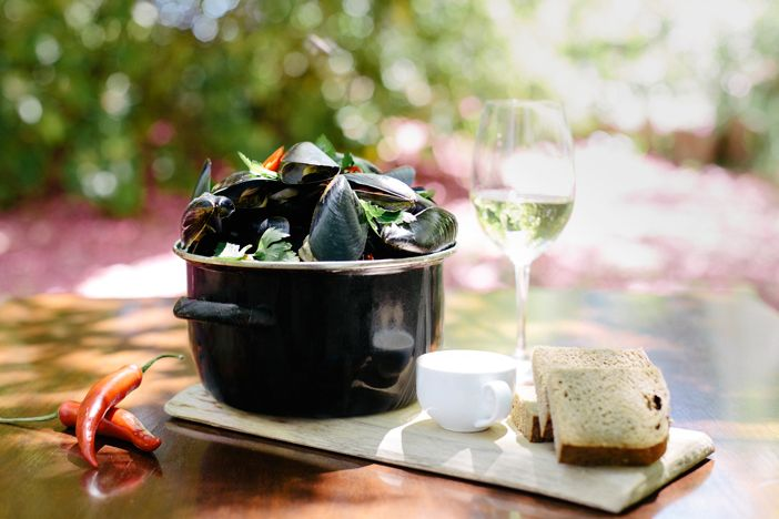 Mussels with fresh bread in Flemish Flavours' summer garden. Advertising Photography by Evangeline Aguas