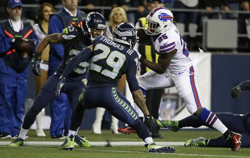 Monday Night Football: Bills vs. Seahawks:   November 7, 2016  - 31-25, Seahawks  -     Buffalo Bills running back LeSean McCoy,, right, rushes against Seattle Seahawks cornerback Richard Sherman, left, and free safety Earl Thomas (29) in the first half of an NFL football game, Monday, Nov. 7, 2016, in Seattle. (AP Photo/Elaine Thompson)