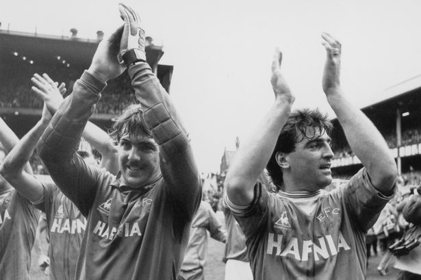 Neville Southall and Kevin Ratcliffe acknowledge the applause of the fans following their 2-0 victory over QPR at Goodison Park which clinched their first League Championship title since 1970
