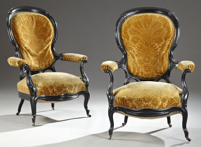 Pair Of Ebonized Louis XV Style Fauteuils With Arched Shield Backs With Brass Tack Upholstery, To Scrolled Upholstered Arms Over Bowed Seats, The Whole On Cabriole Legs   c. Late 19th Century