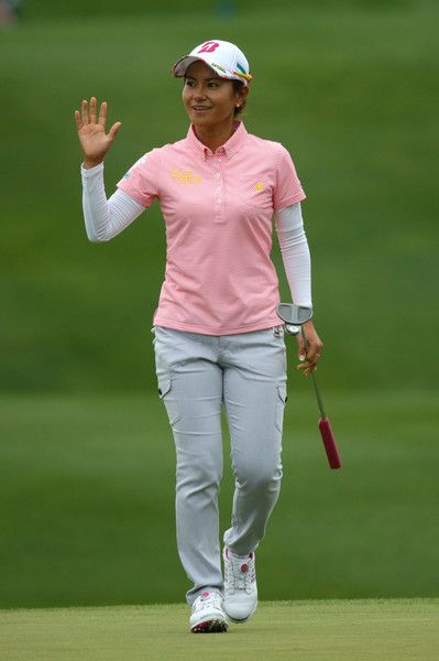 Ai Miyazato Photos - Ai Miyazato of Japan waves to the crowd after making her birdie putt on the 18th hole during the third round of the Kingsmill Championship presented by JTBC on the River Course at Kingsmill Resort on May 21, 2016 in Williamsburg, Virginia. - Kingsmill Championship - Round Three