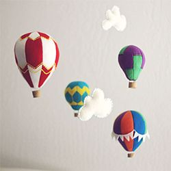 Make a hot air balloon mobile out of felt with this tutorial and pattern.