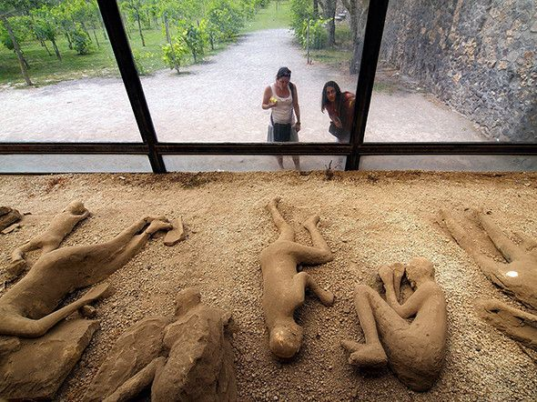Picture of plaster body casts of volcano victims in A.D. 79, Pompeii, Italy