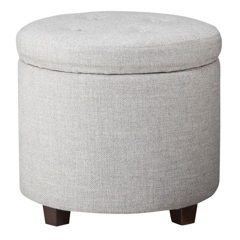 Kick your feet up on the Threshold Round Tufted Storage Ottoman Textured Weave Gray. This attractive, circle ottoman doubles as a storage container...
