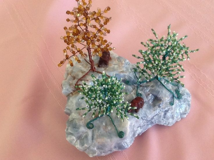 Two gemstone bears, with one crystal bead tree and two seed bead trees $150