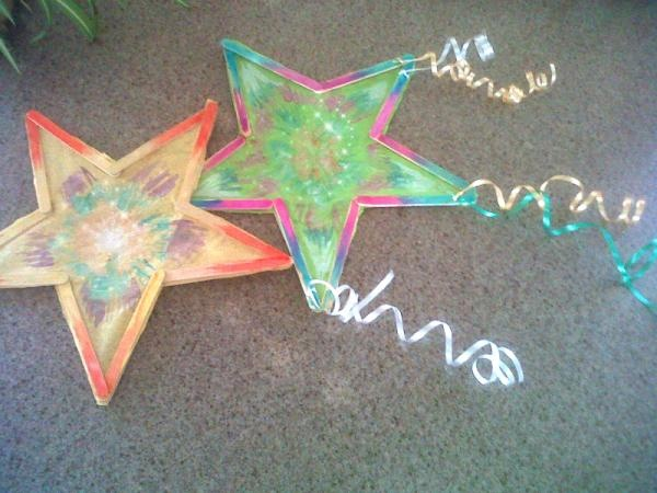 Filipino Parol (Christmas Star Lantern). No instructions but I think you could glue popsicle sticks together, cut stars out of tissue paper and let the kids color each, glue paper to the star.  Add ribbon.