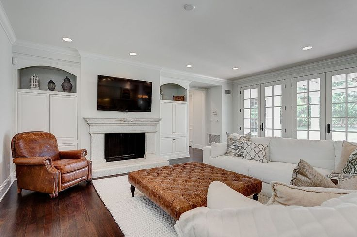 The built in cabinets on either side of the fireplace. LOVE. and the leather chair and ottoman makes the solid couches interesting. Love it all.