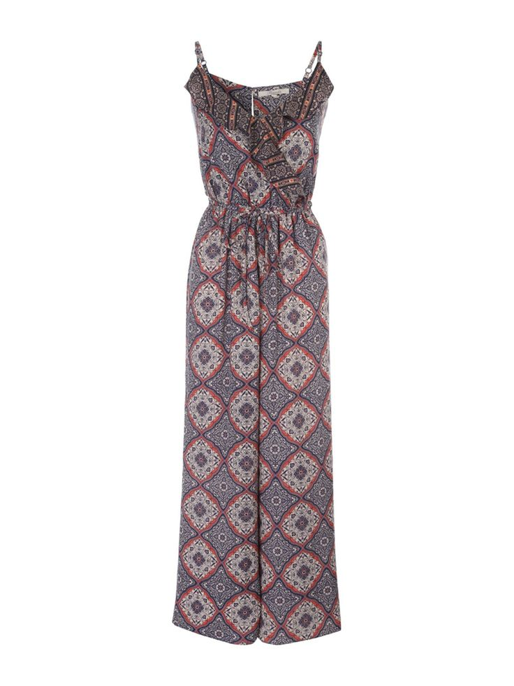 This women's dark blue printed crossover jumpsuit will make a striking addition to your collection of wardrobe staples. With adjustable straps and a wide leg...