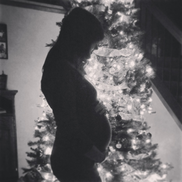 Christmas Baby Belly Photo love the tree idea but maybe with Chris's hands around me
